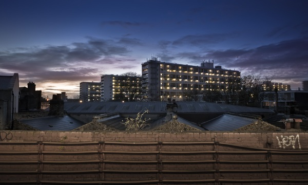 A view from Loughborough Junction Station. The sun was setting behind a few multistory council estate blocks.